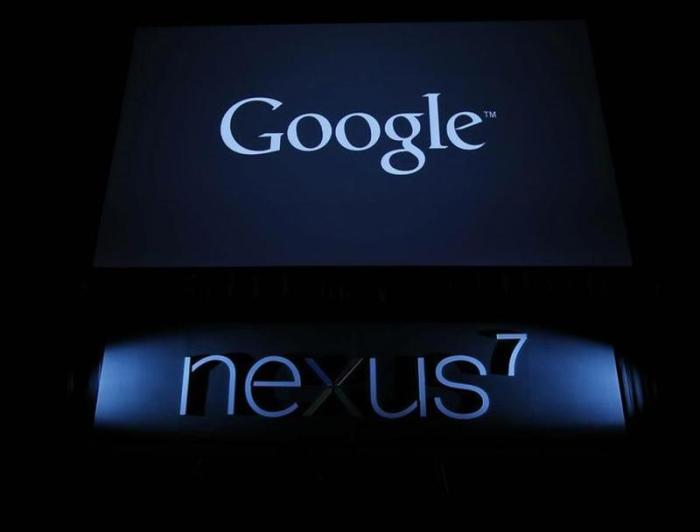 Logos of Google and its Nexus 7 tablet at its promotional event in Tokyo